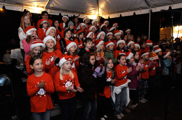 Right side of the Barton Hills Choir performs at the lighting of the Zilker Tree. Photo by Chan Geltemayer.