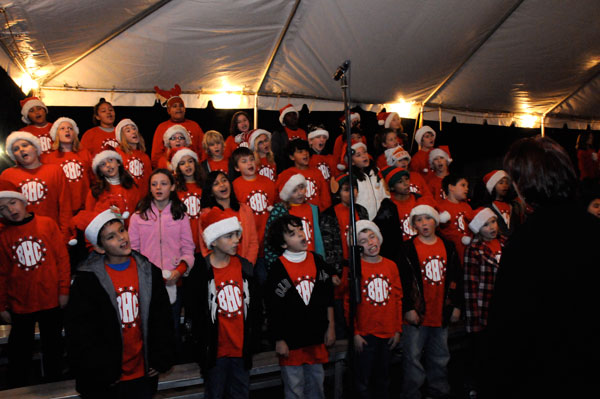 Left side of the choir performs at the lighting of the Zilker Tree. Photo by Chan Geltemayer.